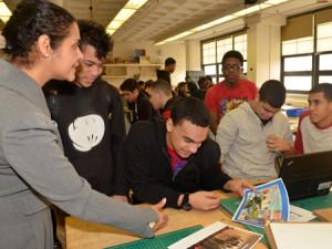 Matthew Soyomayor, Dariel Leonardo, John Fermin, Alberto Gonzalez and Donovan Bembridge explaining the mural design. (Photo by Dara Hutchinson)